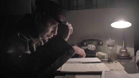 NKVD officer interrogates a prisoner, USSR time 版權商用圖片