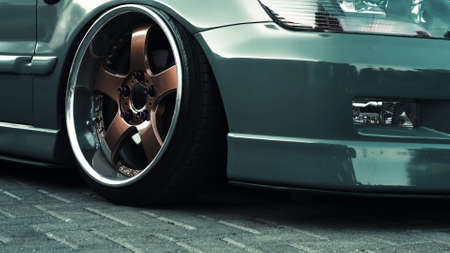 Beautiful dark green sports car with hydraulic suspension