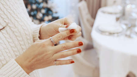 A girl in a white dress rubs her dirty finger with cotton