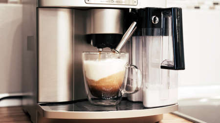 The coffee machine adds coffee to the cream and they mix slowly