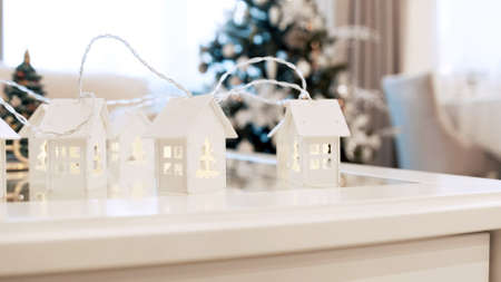 Christmas garland in the form of houses on the table