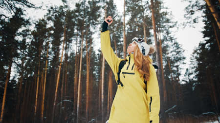Girl trying to catch a bond in the forest in winter Banco de Imagens
