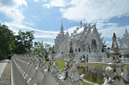white temple spike fence  photo