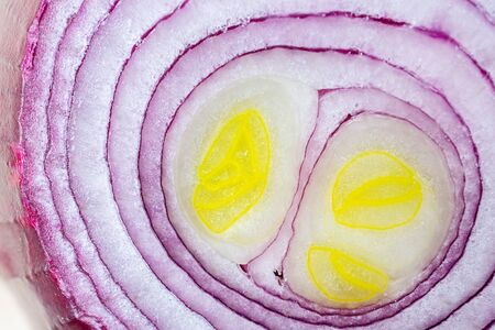 Red sliced onion close-up, detailed macro photo. The concept of healthy vegetables. Textural food background.
