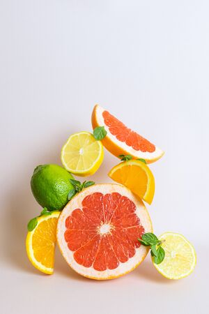 Creative bright composition of orange, grapefruit, lime and lemon. The concept of citrus, summer, vitamin healthy food, vegetarianism.