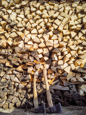 Chopped firewood and two axes close up Stock fotó