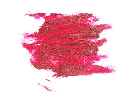 Creamy red lipstick in liquid form, textural strokes isolated on white background. Concept of trends in cosmetics, makeup.