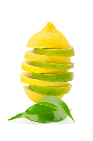 lemon and lime pyramid with leaves isolated on white background Stock Photo