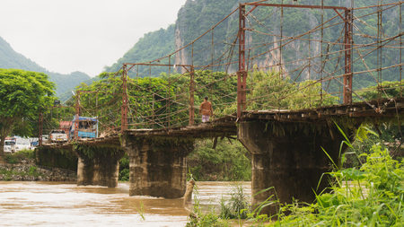 local sling and concrete bridge in vangvieng laos Stock Photo
