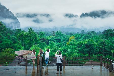 Asian traveler in raining day VangVieng