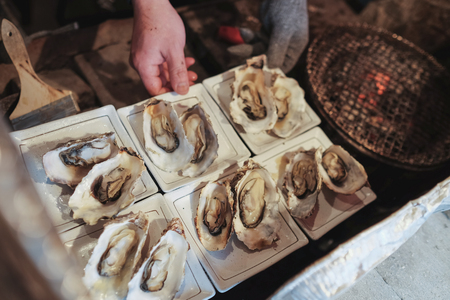 Chef grilled oysters meticulously. To serve tourists arriving at matsushima bay