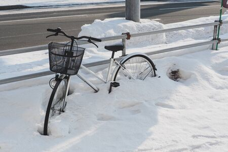 The snow that fell so hard that the furano hokkaido townspeople had encountered a lot of problems. Some people had to dodge in the house until they forgot to keep the bike parked on the side. 写真素材
