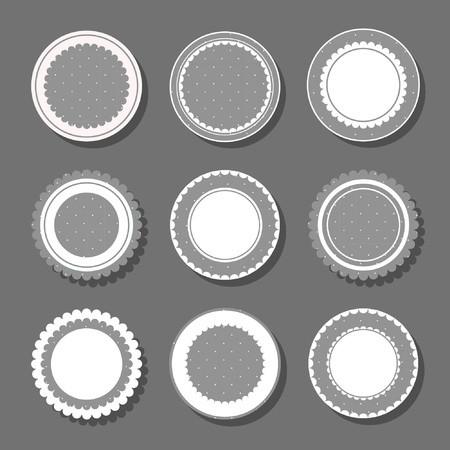 Collection of round cute frames. It are filled with a pattern in polka dots and also decorated with frills. Great for photos, cards, tags, invitations, announcement. Monochrome design Vectores