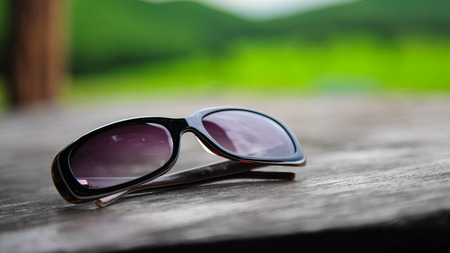 cramming: sunglasses on wooden table Stock Photo