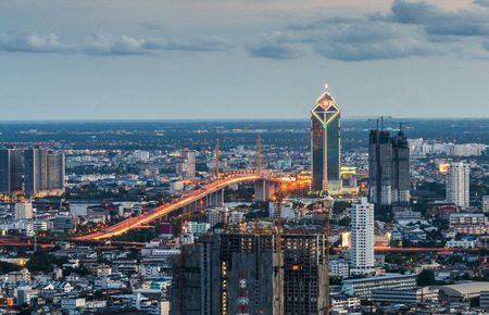 ix: Bangkok cityscape with  Rama IX Bridge at twilight