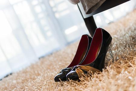 no heels: black high-heeled shoe on carpet