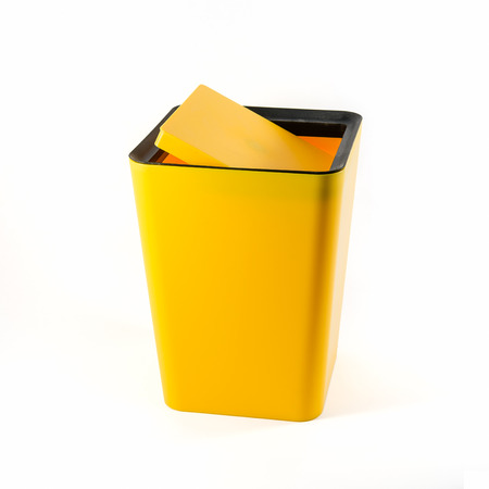Small yellow plastic bin isolated over white background