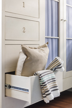 bath towel and pillow in wardrobe at home photo