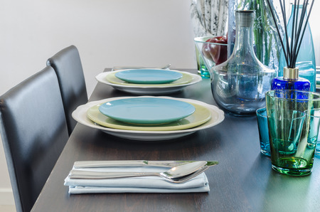 black dinner table with table set at home photo
