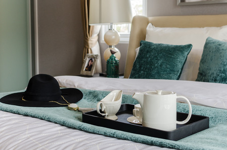 black tray of tea set in modern bedroom at home photo