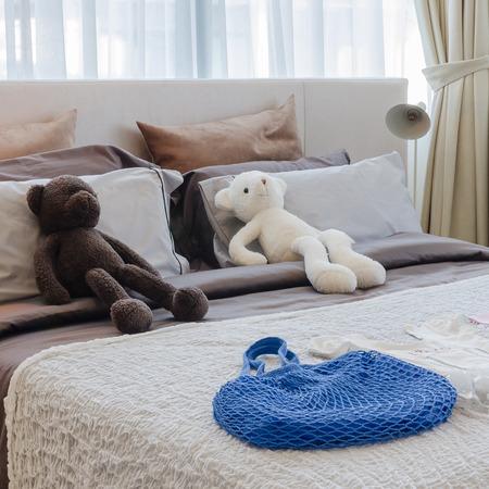 dolls on bed in kid bedroom