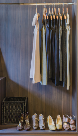dress and shoes in wooden wardrobe at home photo