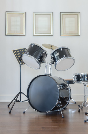 bass drum: Drum and bass set on wooden floor