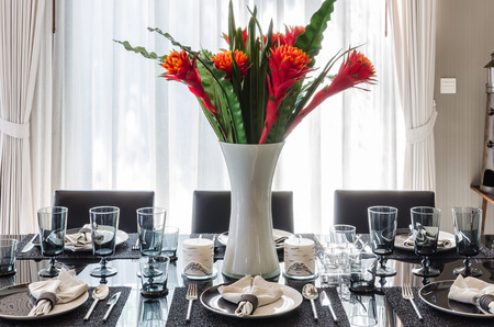 flower in vase on modern dinning table at home photo