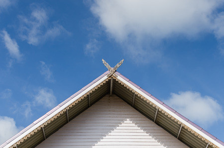 gable house: gable roof of a house in front of the blue sky