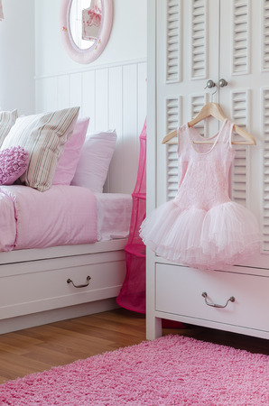 girl dress hanging on wardrobe in bedroom at home photo
