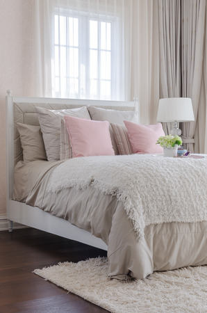 luxury bedroom with pink pillows on bed at home 1dd15db02