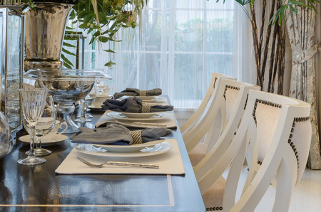 luxury dinning room with table set on wooden table photo