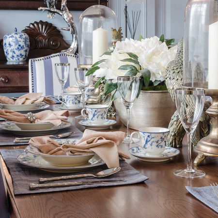dinning table: luxury dinning table set at home Stock Photo
