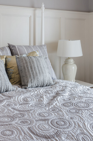king size: luxury king size bed  with white lamp in bedroom at home Stock Photo