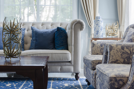 luxury living room with sofa on blue pattern carpet