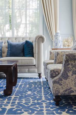 luxury living room with sofa on blue pattern carpet at home