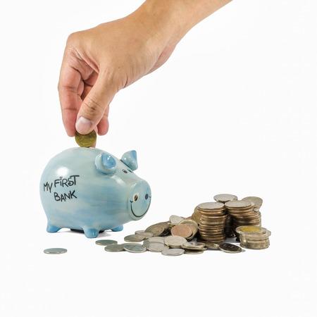 piggybank: Piggybank and coins on white background