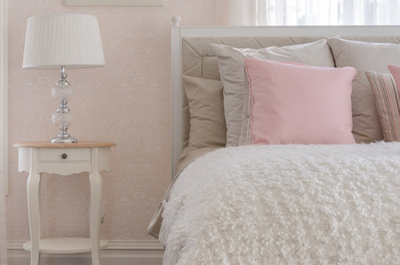 pink pillow on white luxury bed in bedroom at home photo