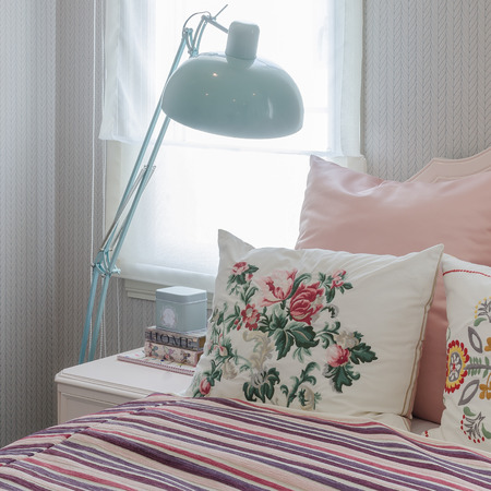 pink pillows on bed in bedroom photo