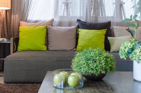 plants in black ceramic vase in living room at home