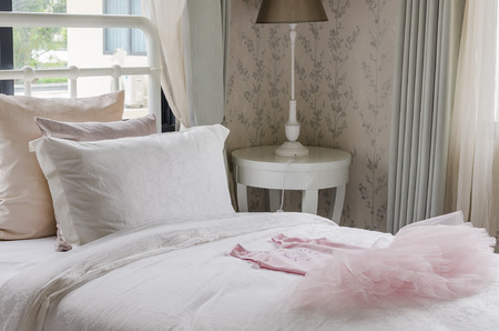 single bed with pink girl's dress