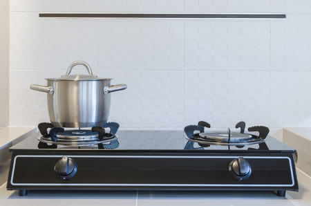 stainless pot on gas stove in kitchen photo