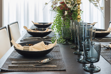 table set in luxury dinning room at home photo