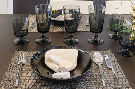 table set on luxury dinning table at home photo