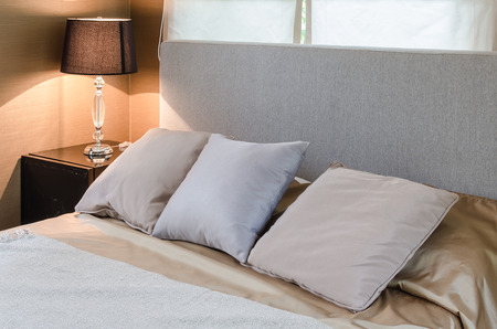 three pillows on bed in bedroom at home photo