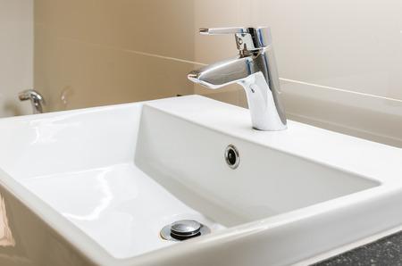 washbasin and faucet at home Standard-Bild
