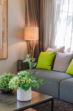 white ceramic vase of plants in living room at home Archivio Fotografico