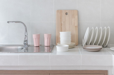 white clean counter in kitchen with utensil at home photo