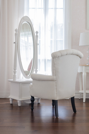 miror: white dressing table and chair with glass miror at home Stock Photo