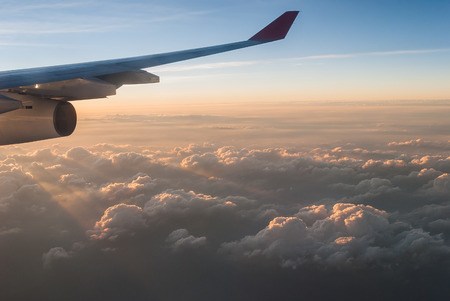 wingtips: wings of airplane in the sky with cloud